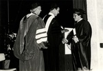 1981 CBR Commencement: Kenneth Howie presents degree to Daniel Kenneth Wood by College of Boca Raton