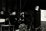 1981 CBR Commencement: Marylou Whitney speaks at podium by College of Boca Raton