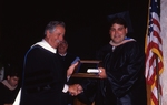 [1992] Frank Robino presents Michael Boden with the Humanitarian Award by Lynn University