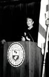 1991 CBR Commencement: Speaker Maureen Reagan at podium by College of Boca Raton