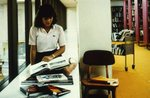 Student Reads Books in the Lewis Library by College of Boca Raton