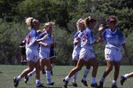 CBR Women's Soccer Team High-Fiving Each Other by College of Boca Raton