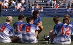 Men's Soccer Team Sitting on the Field by Brad Broome