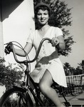 Marymount Student on Bicycle by Norman L. Park
