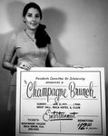 Marymount Student holds a Champagne Brunch Sign